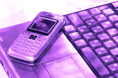 Mobile phone and computer Royalty Free Stock Image