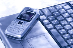 Mobile phone and computer Stock Image