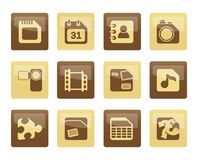 Mobile Phone, Computer and Internet Icons over brown background Royalty Free Stock Photo