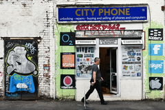 Mobile Phone and Computer Repair Shop. View of a mobile phone and computer repair shop decorated by street art on a city centre street on October 31, 2015 in Stock Images