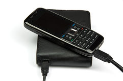 Mobile phone connected to external hard drive Stock Image