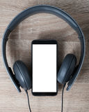 Mobile phone connecting with headphone Stock Image