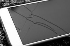 Mobile phone with cracks on the glass. Broken display of modern. Phone stock photo