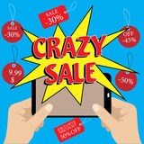 Mobile phone with crazy sale banner. Royalty Free Stock Images