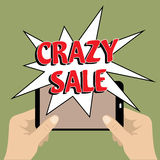 Mobile phone with crazy sale banner Stock Photography