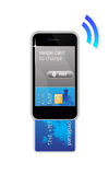 Mobile phone credit card concept. An image for the concept of using a Mobile phone to pay by card credit. The is image shows a super mobile phone like the iPhone Royalty Free Stock Images