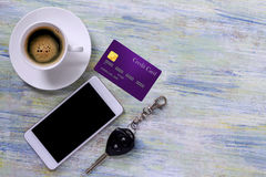 Mobile phone,credit card, cup of coffee and wallet on colorful w Stock Photos