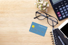 Mobile phone,credit card , glasses and calculator on wood textur Stock Photos