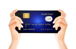 Mobile phone with credit card holded by hands isolated over whit Royalty Free Stock Photography