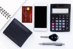 Mobile phone, credit card, wallet and calculator on white table. Stock Photos