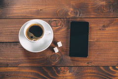 Mobile phone with a Cup of coffee Stock Image