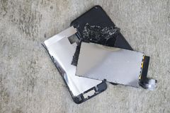 Mobile phone device broken and cracked. Abandoned on street concrete ground stock photo