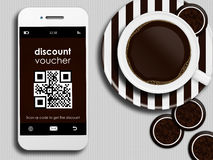 Mobile phone with discount coupon, cup of coffee and gingerbread Royalty Free Stock Images