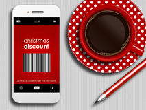 Mobile phone with discount coupon, cup of coffee and pencil lyin Stock Photography