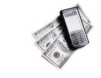 Mobile phone and dollars royalty free stock photography