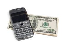 Mobile phone with dollars Stock Photos