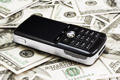 Mobile Phone on Dollars. Mobile phone on a real dollars background Royalty Free Stock Photo