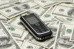Mobile phone and dollars Royalty Free Stock Photo