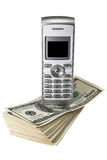 Mobile phone on dollars Royalty Free Stock Image