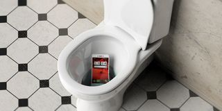 Mobile phone dropped in bathroom toilet bowl, 3d illustration. Mobile phone dropped in bathroom toilet bowl with black and white tiles, view from above. 3d Royalty Free Stock Photography