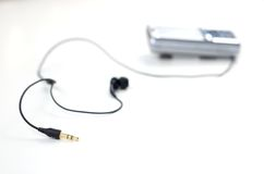 Mobile phone with earphones Royalty Free Stock Photo