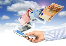 Mobile phone and euro money. Royalty Free Stock Photos