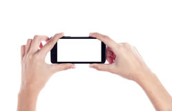 Mobile phone in female hand isolated on a white background, to c Stock Photo