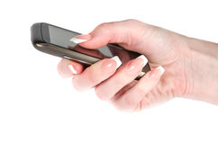 Mobile phone in a female hand. The mobile phone in a female hand on a white background. High-quality 3d render Royalty Free Stock Photo