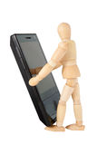 Mobile phone and figurine Royalty Free Stock Photo
