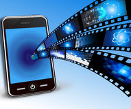 Mobile phone and films Stock Photography