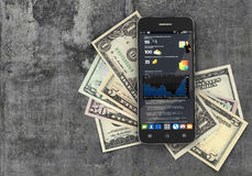 Mobile phone with finance statistic in the screen. And money on concrete background. Concept of payment and savings. 3d illustration Stock Photography