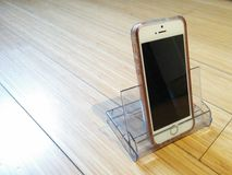 Mobile phone on the floor. Mobile phone on a home made support Royalty Free Stock Image