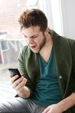 Mobile phone frustration Stock Photo