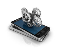 Mobile phone and gears. Application development concept. Stock Photography