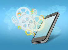 Mobile phone and gears Stock Photography