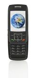 Mobile phone with globe. Close-up of slide phone with globe - the image on the screen has a clearly visible net simulating display pixels Stock Image