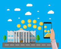 Mobile phone with gold coins and bank building. Hand holding mobile phone with gold coins inside and bank building. Mobile payment, mobile banking, money Royalty Free Stock Images
