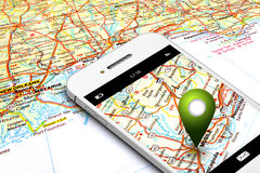 Mobile phone with gps and map in background Royalty Free Stock Photos