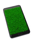 Mobile phone with grass Stock Photo