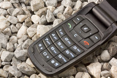 Mobile Phone on the Gravel Royalty Free Stock Image