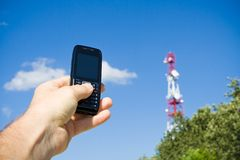 Mobile phone and GSM frustration. Mobile phone looking for the best reception. GSM frustration Stock Images