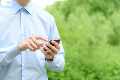 Mobile phone in hand royalty free stock photography
