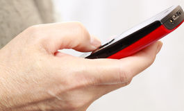 Mobile phone With hand Stock Photography