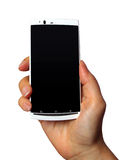 Mobile phone in hand. White mobile phone in hand isolated on white background Stock Photography
