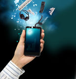 Mobile phone. In the hand Royalty Free Stock Images