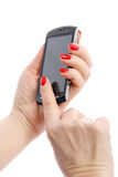 Mobile phone with hand Royalty Free Stock Images