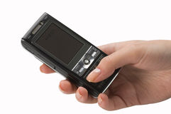 Mobile phone in hand Royalty Free Stock Photos