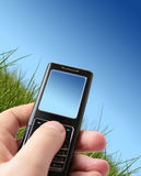 Mobile phone in hand. Royalty Free Stock Photography