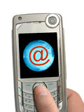 Mobile phone in hand, email and Earth on display. Mobile phone in hand, email symbol and Earth on display, isolated Stock Images