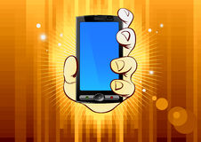 Mobile phone in hand on gold background Royalty Free Stock Image